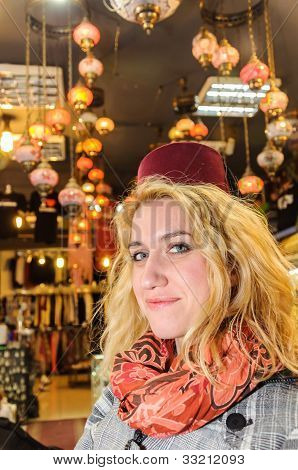 Blonde with fez on head