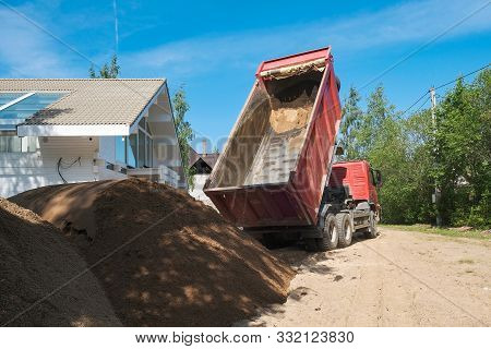 Truck Pours Sand On The Construction Site