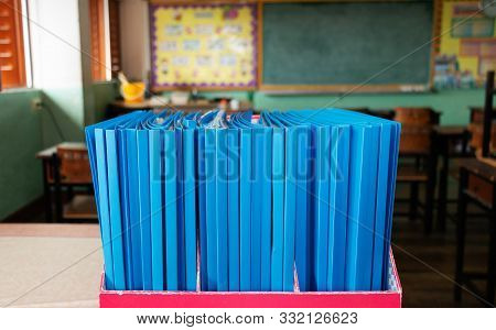 Blue Portfolio In Red Box On Table In Elementary Clssromm