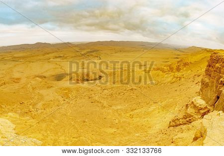 Panoramic Sunset View Of Makhtesh (crater) Ramon, In The Negev Desert, Southern Israel. It Is A Geol