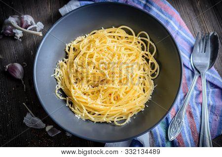Pasta Aglio Olio On A Plate Dark Mood Photo Top View