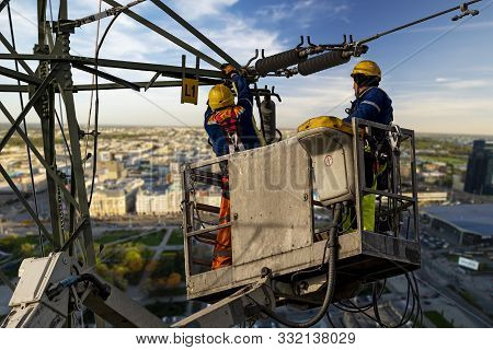 Electrical Engineer Repairing The Electrical Network On An Elevation Boom