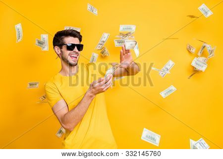 Photo Of Young Handsome Careless Guy Throwing Usa Money Banknotes Away Wealthy Person Wear Sun Specs