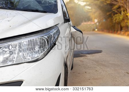 Car Accident On Road Car Door And Rearview Mirror  Broken. Front Of White Color Car Damaged And Brok