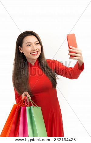 Beauty Women Wear Aodai Selfie While Hold Shopping Bags In Lunar New Year