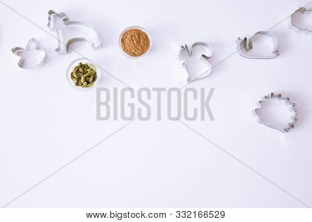 Animal Cookie Cutters On White Table, Top View. Cinammon And Cardamom Spice. Space For Text, Copy-sp