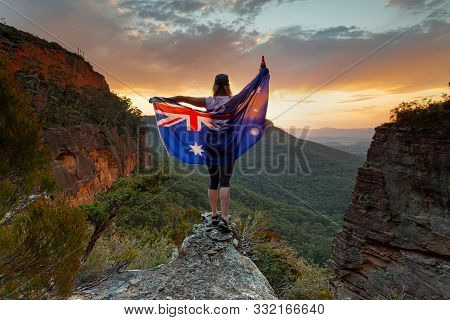 Patrotic Woman Holding Australian Flag In Blue Mountains Australia.  Celebrate Australia Day, Sports