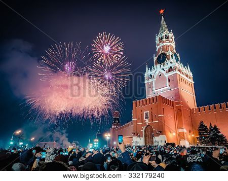 New Years Eve In Moscow. Fireworks On Red Square Near The Spasskaya Tower On New Years Eve. Multicol