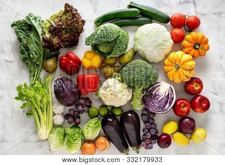 Healthy Food Concept. Vegetables And Fruits On Light Background