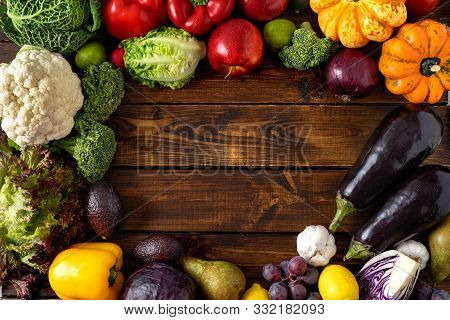 Healthy Food Concept. Vegetables And Fruits On Wooden Background