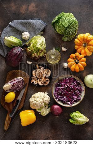 Top View Of Cutting Vegetables On Rustic Table