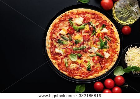Top View Of Appetizing Vegetarian Pizza With Cheese And Vegetables