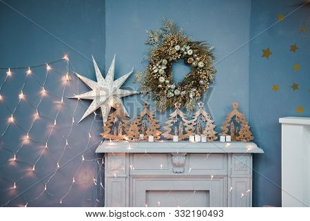 Fireplace With Christmas Decor. Beautiful New Years Interior With A White Fireplace. Christmas Inter