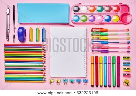 Bright Composition From A School Stationery On A Pink Background