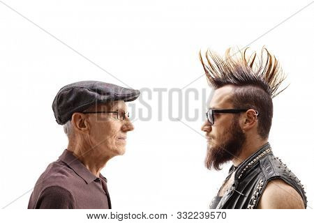 Young punk and a senior man looking at each other isolated on white background