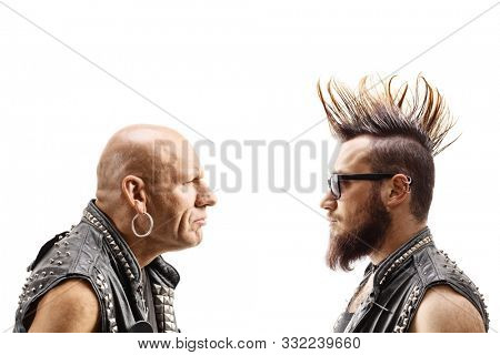 Young punker with a mohawk and an older bald punker looking at eachother isolated on white background