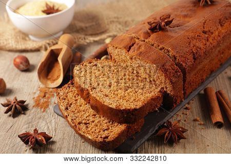 gingerbread cake with spices on wood background