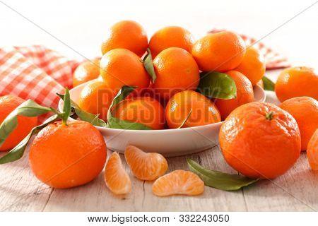 clementine or mandarin, citrus fruit and leaf