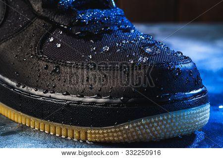 Water Drops On Waterproof Membrane Fabric Of Shoes Surface, Macro Shot. New Waterproofing Technology