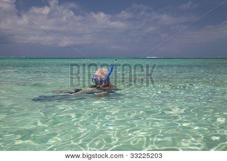 Older middle-aged man snorkeling