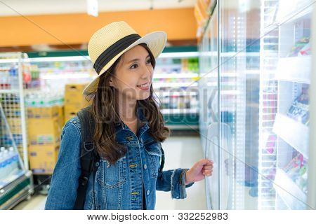Woman buy something in convenient store