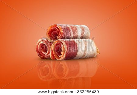 Palatable Slices Of A Rolled Bacon On An Orange Background With Copy Space For Text Or Images, Mirro