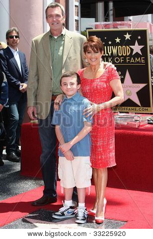 LOS ANGELES - MAY 22: Patricia Heaton, Neil Flynn, Atticus Shaffer at a ceremony honoring Patricia Heaton with a Star on The Hollywood Walk of Fame on May 22, 2012 in Los Angeles, California