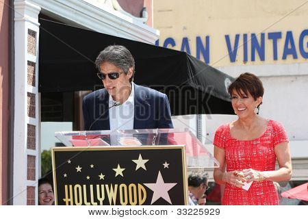 LOS ANGELES - MAY 22: Patricia Heaton, Ray Romano at a ceremony honoring Patricia Heaton with a Star on The Hollywood Walk of Fame on May 22, 2012 in Los Angeles, California