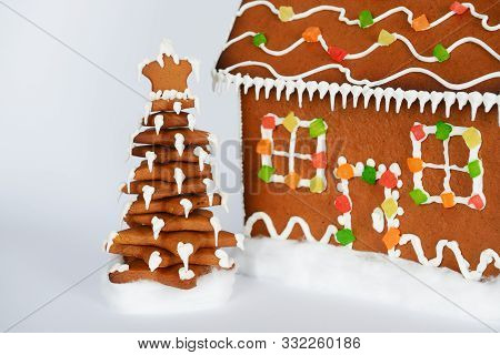 The Hand-made Eatable Gingerbread New Year Tree And House In Snow Decoration