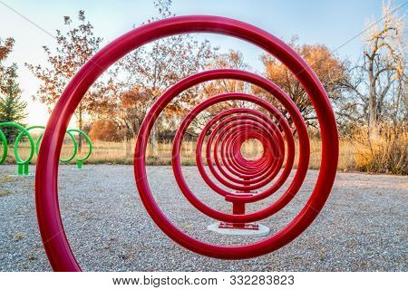 colorful spiral shape bike racks along a trail in Fort Collins, Colorado - outdoor activity and bike commuting concept