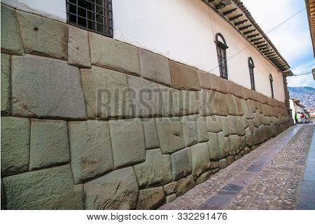 Cusco, Peru - Jan 7, 2019: Historic Colonial Buildings in Hatun Rumiyoc street , Cusco,  Peru.