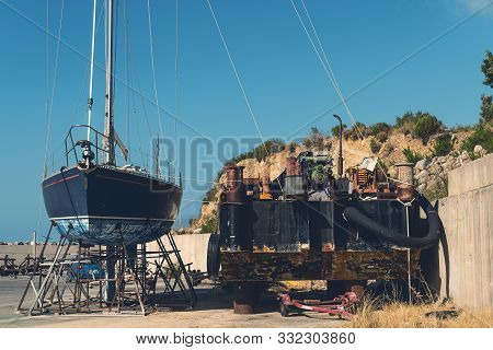 Old Blue Sailing Boat In Dry Dock