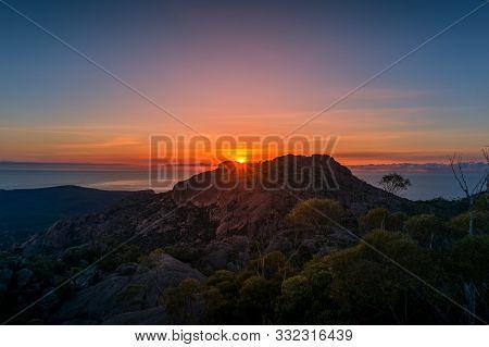 Mountain Sunrise Landscape. Mountain Peak With Sun Raising Above The Rock. Beautiful Nature Scene Ba