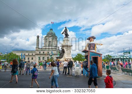 Quebec City, Canada - August 6, 2015:people Stroll On The Dufferin Terrace Near The Famouse Frontena