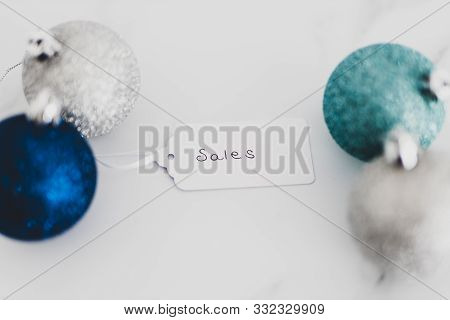 Festive Season Shopping Sales Price Tag With Blue And Silver Chirstmas Baubles