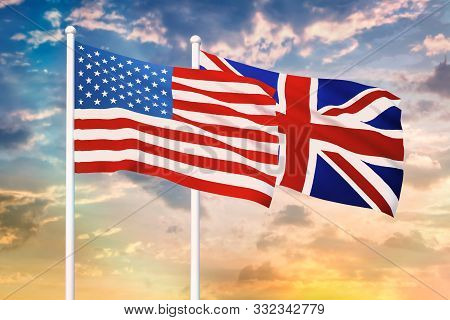 Relationship Between The Usa And The United Kingdom. Two Flags Of Countries On Heaven With Sunset. 3