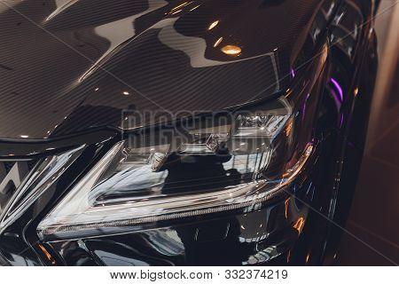 Closeup Headlights Of Car White Body Close-up. Gray Body