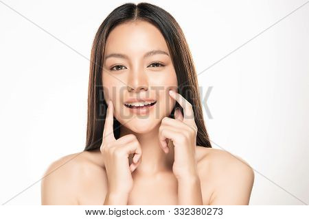 Beautiful Young Asian Woman Touching Soft Cheek And Smile With Clean And Fresh Skin. Happiness And C