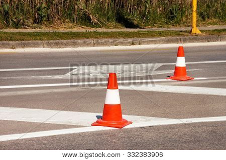 Work On Road. Construction Cones. Traffic Cone, With White And Orange Stripes On Asphalt. Street And