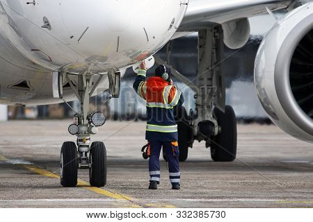 A Ground Control Manager Prepares For Departing Of Aircraft From The Airport