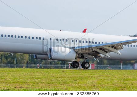 Airplane Landing On Runway Touchdown Close Up Side View Fuselage