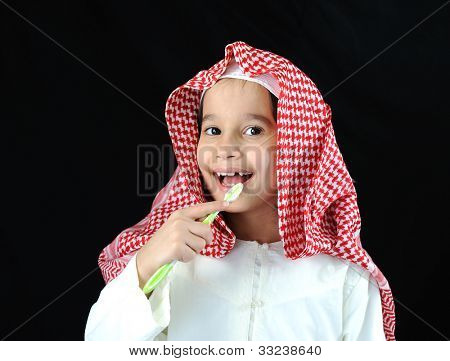 Arabic boy with toothbrush