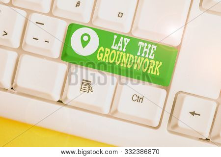 Writing note showing Lay The Groundwork. Business photo showcasing Preparing the Basics or Foundation for something White pc keyboard with note paper above the white background. poster