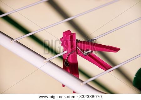 Cloth Clothespins On Drying Rack, Selective Focus. Colorful Plastic Clothespins On Clothesline. A Lo