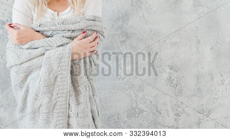 Vulnerable, Sensitive Female Nature. Woman In Gray Warm Handmade Knitted Blanket.