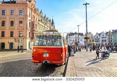 Plzen, Czechia - Oct 28, 2019: Vintage Red Bus On The Main Square In Pilsen, Bohemia, Czech Republic