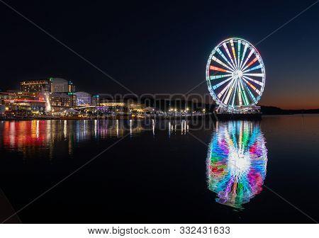 National Harbor, Maryland - 6 November 2019: Illuminated Capital Wheel Ferris Ride At National Harbo