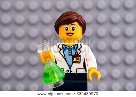 Tambov, Russian Federation - October 19, 2019 Lego Scientist Minifigure With Green Flask Against Gra