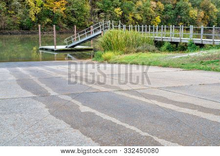 dock and boat ramp on Tennessee River in fall scenery,  Colbert Ferry along Natchez Trace Parkway, travel and recreation concept