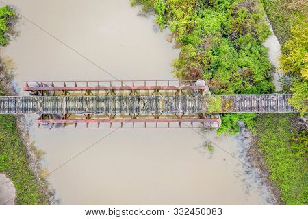 trestle of abandoned railway across Cache River in Illinois above confluence with the Mississippi River, aerial view of fall scenery